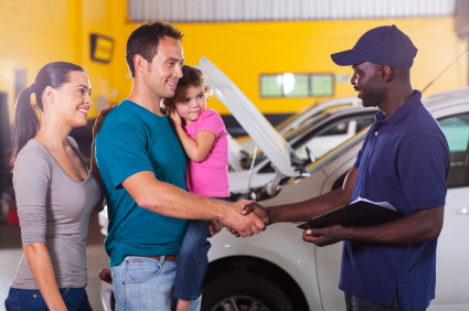 friendly mechanic handshaking with family